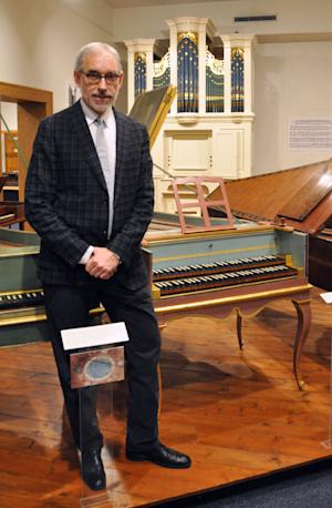Cleveland Johnson, new director of the National Music Museum, stands in front of some historic keyboard instruments in the museum's Abell Gallery, Thursday, Jan. 10, 2013, in Vermillion, S.D. The museum is embarking upon a $15 million expansion to better showcase its more than 15,000 instruments. (AP Photo/Dirk Lammers)