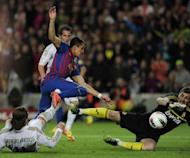 "Barcelona's forward Alexis Sanchez (up) scores despite Real Madrid's defender Sergio Ramos (L) and goalkeeper Iker Casillas (R) during the Spanish League ""El Clasico"" football match at the Camp Nou stadium in Barcelona. Real Madrid won 2-1"
