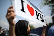 A Barisan National party supporter displays a placard during a campaign rally in Kuala Lumpur on April 22, 2013. Malaysia is bracing for long-anticipated elections that have raised speculation of the country's first change of regime since independence from Britain in 1957