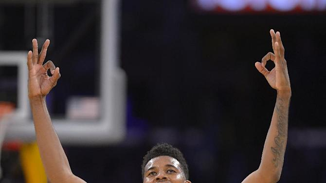 Los Angeles Lakers forward Nick Young celebrates during the second half of an NBA basketball game against the Detroit Pistons, Sunday, Nov. 17, 2013, in Los Angeles