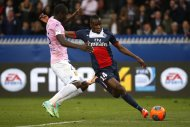 Paris St Germain's Blaise Matuidi (R) scores a goal against Jonathan Mensah of Evian Thonon Gaillard during their French Ligue 1 soccer match at the Parc des Princes Stadium in Paris, April 23, 2014. REUTERS/Benoit Tessier (FRANCE - Tags: SPORT SOCCER)