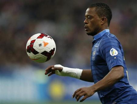 France's Evra controls the ball during the 2014 World Cup qualifying soccer match against Finland at the Stade de France stadium in Saint-Denis, near Paris
