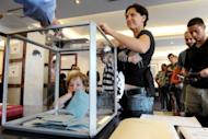 French citizens are lining up to vote at the French consulate general in Sydney, on April 22, in the first round of the country's presidential election that pits Socialist Francois Hollande against incumbent Nicolas Sarkozy. Nearly 15,000 French citizens are eligible to cast votes at eight centres across Australia