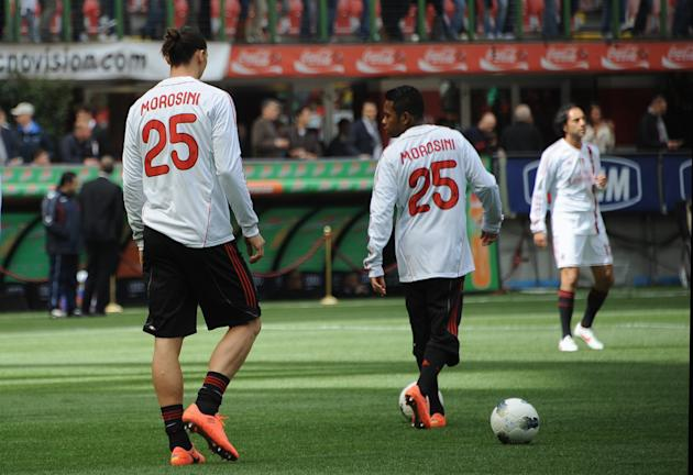 AC Milan's Swedish forward Zlatan Ibrahimovic (L) and his team mates wear  warm-up jerseys with the name of  Piermario Morosini, the Italian football player who died last Saturday on the field, before