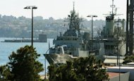 Australian Navy ships are shown at the Garden Island Naval Dockyard, near Sydney in May 2012. Australia's Navy rescued more than 200 asylum-seekers from a boat off Indonesia, officials said Friday, amid reports naval ships are literally cracking under the strain of responding to a flood of boatpeople