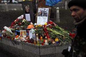 A man passes by a small memorial dedicated to people…