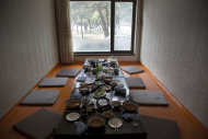"""In this June 15, 2014 photo, the remains of lunch sits on a restaurant table in the city of Wonsan, North Korea. The Associated Press was granted to embark on a weeklong road trip across North Korea to the country's spiritual summit Mount Paektu. The trip was on North Korea's terms. An AP reporter and photographer couldn't interview ordinary people or wander off course, and government """"minders"""" accompanied them the entire way. (AP Photo/David Guttenfelder)"""