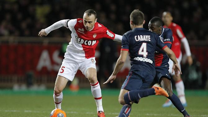 Monaco's Dimitar Berbatov of Bulgaria challenges for the ball with Paris Saint Germain's Yohan cabaye of France during their French League One soccer match, in Monaco stadium, Sunday, Feb. 9 , 2014