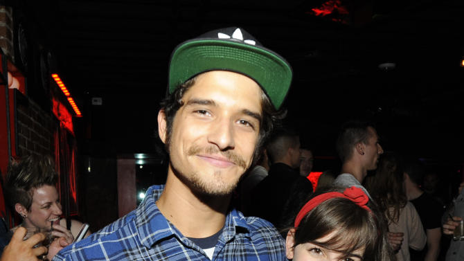 Actor Tyler Posey poses with a friend at the 3rd Annual KINGS OF CON party, on Thursday, July 18, 2013, in San Diego, Calif. (Photo by Jack Dempsey/Invision for KINGS OF CON/AP Images)