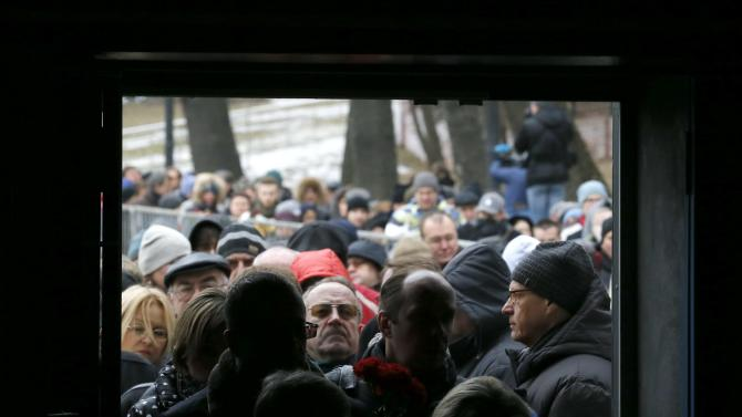 People stand in a line to attend a memorial service before the funeral of Russian leading opposition figure Nemtsov in Moscow