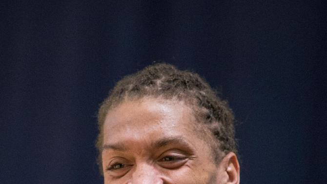 Miami Heat forward Michael Beasley smiles as he speaks with reporters after training at the Atlantis resort on Paradise Island, Bahamas, Wednesday, Oct. 2, 2013. The two-time defending NBA champions are holding a one week training camp at the resort