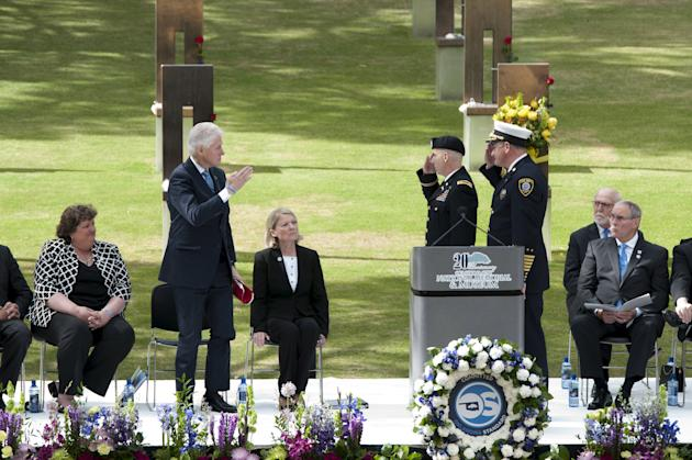 Clinton salutes Major Katz, and Oklahoma City Fire Department Chief Bryant during the 20th Remembrance Ceremony, the anniversary ceremony for victims of the 1995 Oklahoma City bombing, at Oklahoma Cit