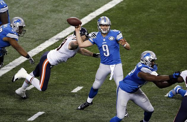 Chicago Bears defensive end Jared Allen (69) knocks the ball away from Detroit Lions quarterback Matthew Stafford (9) during the first half of an NFL football game in Detroit, Thursday, Nov. 27, 2014.