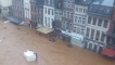 Submerged Vehicles Line Streets in Eastern Belgium Amid Heavy Rains