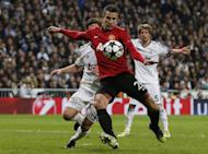 Manchester United's Robin van Persie keeps Real Madrid players at bay during the match in Madrid on February 13, 2013. Manchester City defender Pablo Zabaleta insists his side are determined to avoid becoming the latest high-profile victims of the FA Cup's giant-killing tradition when they face Leeds in the fifth round