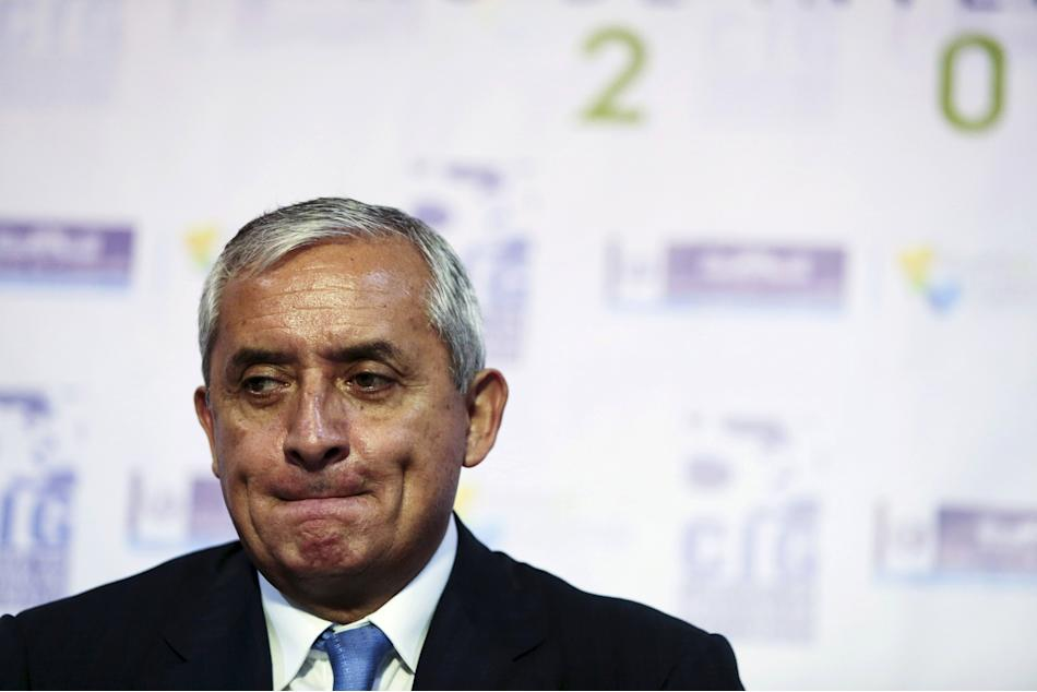 File photo of Guatemalan President Perez reacting during a news conference in Guatemala City