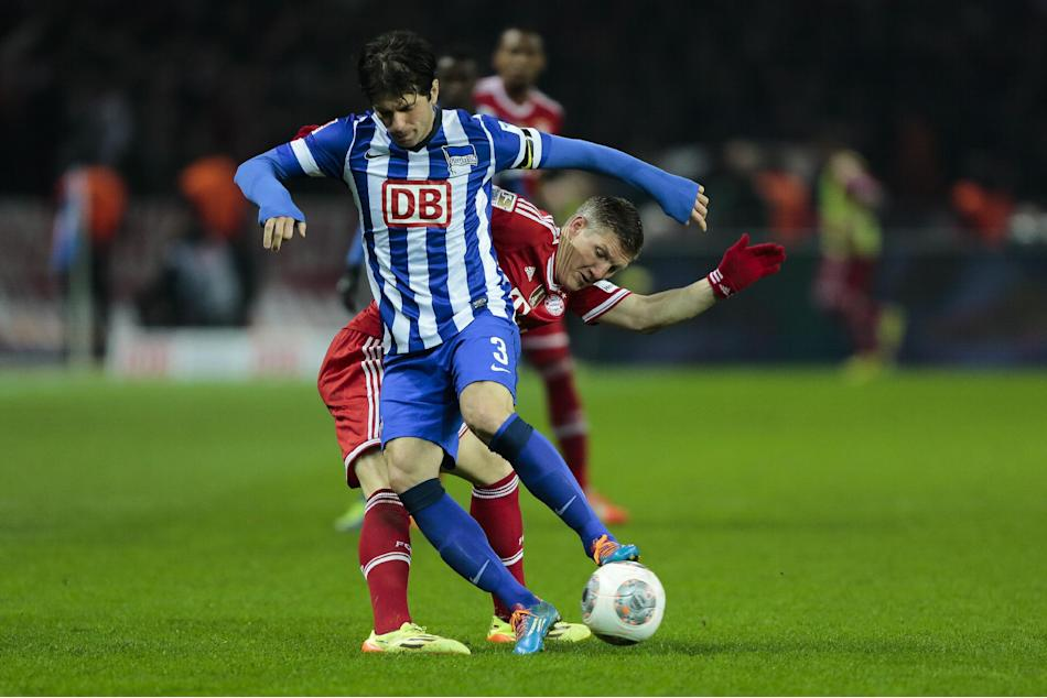Berlin's Levan Kobiashvili, left, of Georgia and Bayern's Bastian Schweinsteiger challenge for the ball during the first division Bundesliga soccer match between Hertha BSC and FC Bayern Munic