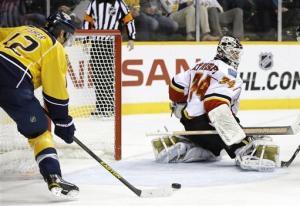 Fisher helps Predators beat Flames 5-3