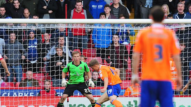 Matt Smith, right, salvages a point for Oldham, which manager Paul Dickov felt they deserved