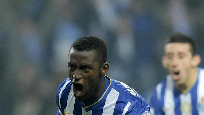 FC Porto's Jackson Martinez, from Colombia, celebrates after scoring the opening goal against Sporting Braga in a Portuguese League soccer match at the Dragao Stadium in Porto, Portugal, Saturday, Dec. 7, 2013