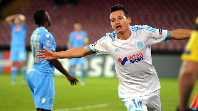 Marseille's Florian Thauvin celebrates after scoring during a Champions League, group F, soccer match between Napoli and Marseille, at the Naples San Paolo stadium, Italy, Wednesday, Nov. 6, 2013