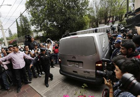 A funeral hearse reverses for parking, outside the home of Colombian Nobel Prize laureate Gabriel Garcia Marquez in Mexico City