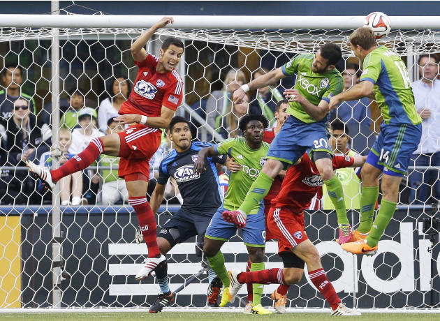 FILE -  In this May 7, 2014, file photo, FC Dallas goalkeeper Raul Fernandez, second from left, and Dallas' Matt Hedges, left, watch as Seattle Sounders' Zach Scott (20) and Chad Marshall, rig