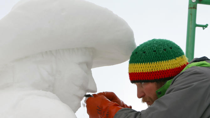 The captain of Team USA Breckenridge, Keith Martin shaving away snow of a bull rider's mustache on his 12 foot tall, 20-ton sculpture at the outdoor art gallery during the 23rd Annual International Snow Sculpture Championships in Breckenridge, Colo., on Friday, Jan. 25, 2013. Martin is joined with 15 international teams, the sculptures will remain on display through Feb. 3, 2013 (weather permitting). Visit www.gobreck.com for more information. (Nathan Bilow / AP Images for The Breckenridge Resort Chamber)
