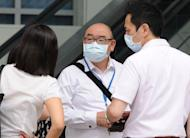 People wear face masks as haze worsens in Singapore on June 19, 2013. The haze is expected to persist into Thursday because of the wind direction, with the health ministry advising residents to limit prolonged or heavy outdoor activities