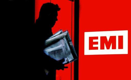 A man leaves an EMI Record company building in London in 2007. The European Commission on Friday cleared Universal's $1.9 billion takeover of EMI's iconic recorded music division after it agreed to sell substantial parts of the business to meet competition issues.