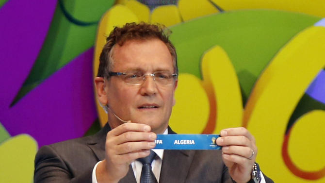 "FIFA Secretary General Jerome Valcke holds the slip showing ""Algeria"" during the draw for the 2014 World Cup at the Costa do Sauipe resort in Sao Joao da Mata"
