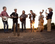 "This undated image released by ATO Records shows members of Old Crow Medicine Show, from left, Kevin Hayes, Gill Landry, Chance McCoy, Ketch Secor, Morgan Jahnig, and Critter Fuqua. The band's fourth album is called. ""Carry Me Back."" (AP Photo/ ATO Records)"