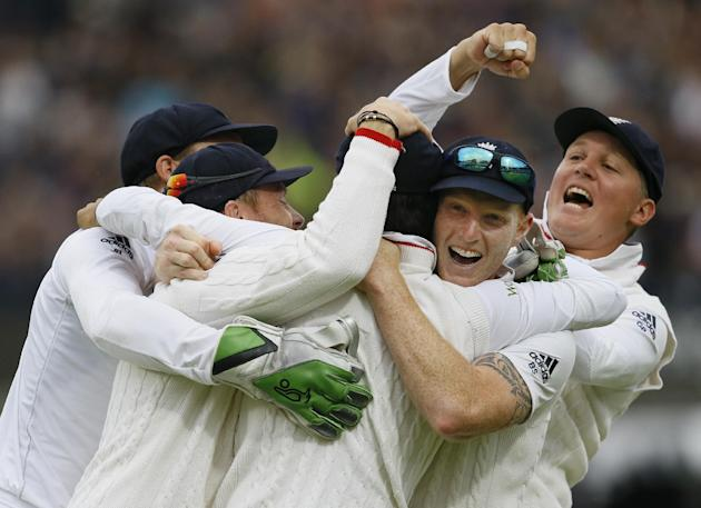 England's players hug Moeen Ali, centre, after he catches out New Zealand's Trent Boult to win the match, on the fifth day of the first Test match between England and New Zealand at Lord's