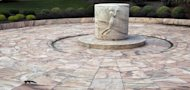 A squirrel runs at the George Eastman Memorial where Eastman's ashes rest in an urn beneath the central stone in Rochester, N.Y., Monday, Oct. 3, 2011. (AP Photo/David Duprey)