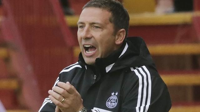 Football - McInnes delights in solid win