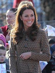 Kate Middleton has just arrived at Rose Hill School in Oxford wearing another fit-and-flare coat dress, this time by Orla Kiely. She's