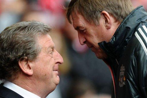 Liverpool's manager Kenny Dalglish (R) and West Bromwich Albion's manager Roy Hodgson