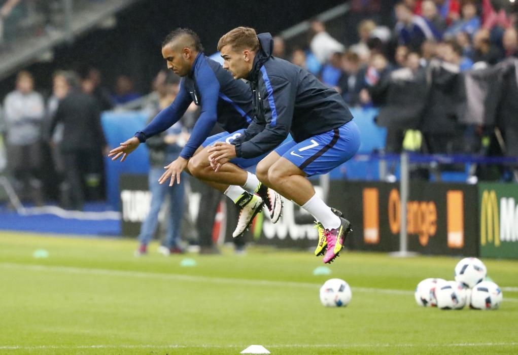France's Antoine Griezmann and Dimitri Payet warm up before the game