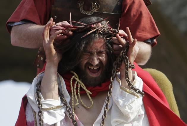"Actors portraying Jesus Christ and a Roman soldier perform the scene of the crowning of thorns during ""the Passion of Christ"" play in Ceska Lipa"