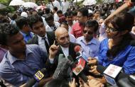 V.K. Anand (C), defence lawyer for one of the four men who were found guilty of the fatal gang-rape of a young woman on a bus in New Delhi, speaks with the media after the verdict in New Delhi September 10, 2013. REUTERS/Adnan Abidi
