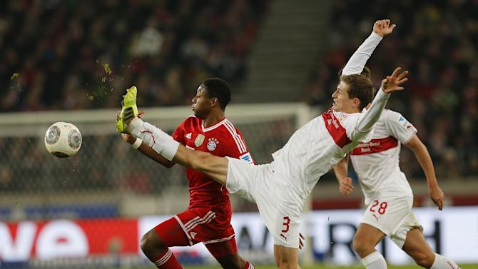 Stuttgart's Daniel Schwaab, right, and Bayern's David Alaba of Austria challenge for the ball during a German first soccer division Bundesliga match between VfB Stuttgart and FC Bayern Munich in Stuttgart, Germany, Wednesday, Jan. 29, 2014