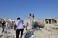 Syrians search for people trapped under the rubble following an air strike in the town of Aazaz, near the northern restive Syrian city of Aleppo
