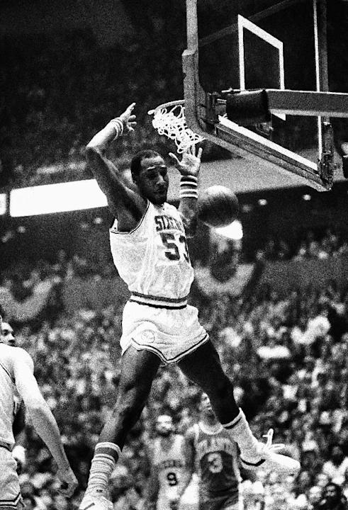 FILE - In this April 15, 1980, file photo, Philadelphia 76ers' Darryl Dawkins dunks against the Atlanta Hawks in an NBA playoff game in Philadelphia. Darryl Dawkins, whose backboard-shattering dun