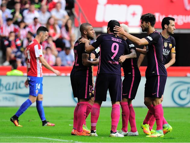 Barcelona's midfielder Rafael Alcantara (2nd L) is congratulated by teammates after scoring a goal against Real Sporting de Gijon during a Spanish league football match at El Molinon stadium in Gi