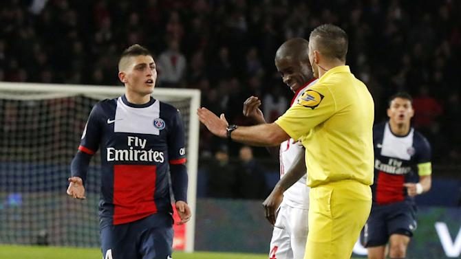 Paris-Saint-Germain's Zlatan Ibrahimovic of Sweden lies on the ground, foreground, while his teammate Marco Verratti of Italy, background left, Lille's Antonio Mavuba, background center, and referee Fredy Gautrel, background right,  gestures as he argues with Mavuba during a French league one soccer match between Paris-Saint-Germain and Lille at Parc des Princes stadium in Paris, Sunday Dec. 22, 2013. Ibrahimovic and Mavuba were booked for shoving each other