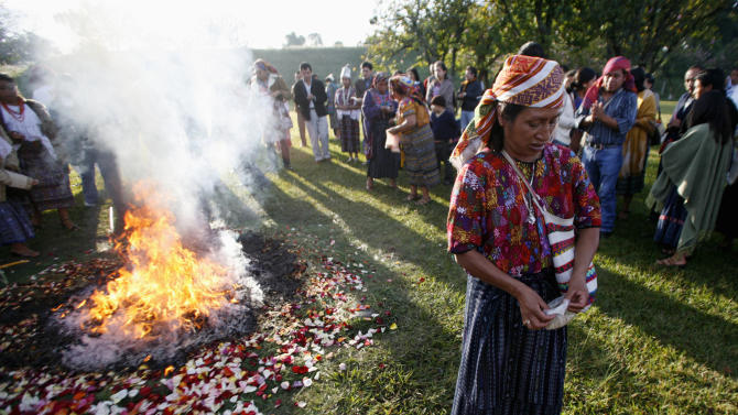 An indigenous woman takes part in a Mayan ceremony outside Guatemala City