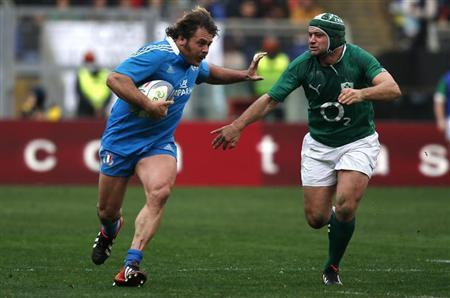 Italy's Andrea Lo Cicero challenges Ireland's Rory Best during their Six Nations international rugby union match in Rome