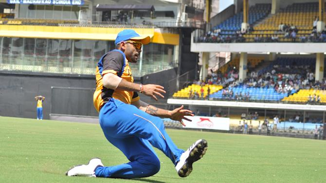 Virat Kohli in action during N K P Salve Challenger Trophy between India Blue and Delhi at Holkar Cricket Stadium in Indore on Sept. 26, 2013. (Photo: IANS)