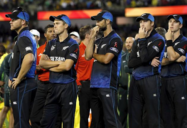 New Zealand players react as they watch the presentation ceremony after losing the final match against Australia at the MCG
