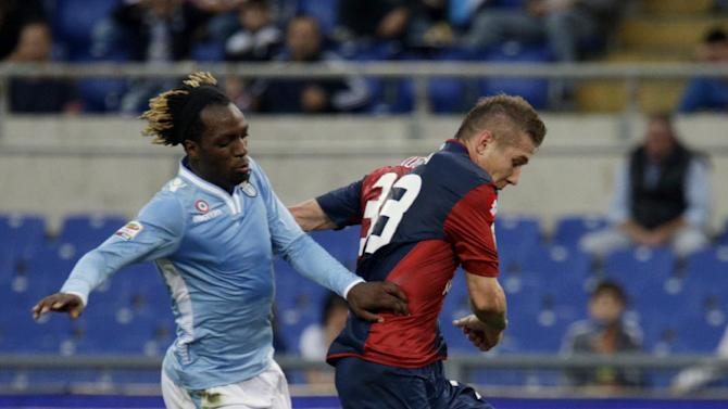 Genoa midfielder Juraj Kucka,of Slovakia, right, scores past Lazio defender Luis Cavanda, of Belgium, during a Serie A soccer match between Lazio and Genoa, at Rome's Olympic stadium, Sunday, Nov. 3, 2013